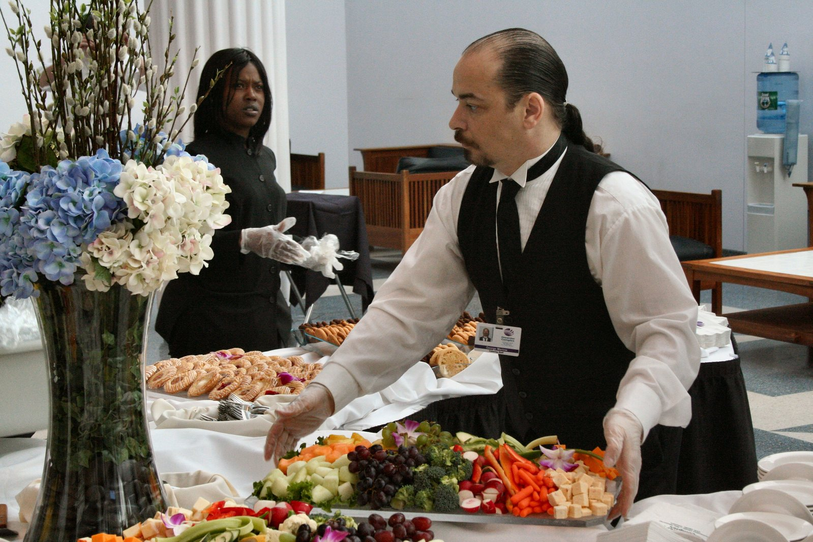 Catering staffers scurry to set tables for a social function in Syracuse NY. 2007-04-29.